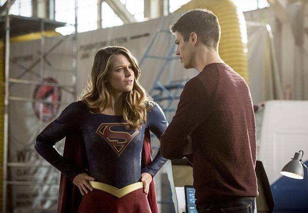 Melissa Benoist as Kara and Grant Gustin as Barry Allen.