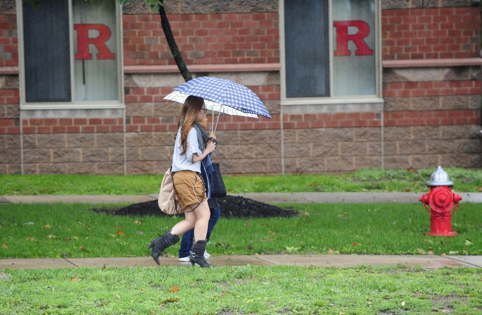 A student walks past the dormitory at Rutgers Univeristy in New Brunswick, New Jersey on October 01, 2010 where first-year student Tyler Clementi, 18, lived and was allegedly filmed and broadcast over the Internet during a gay encounter. Clementi killed himself shortly after being spied on. Two undergraduates have been arrested after the fellow student they allegedly filmed and broadcast over the Internet leapt to his death from a New York bridge. Prosecutors said that two students at Rutgers had been charged with invasion of privacy and that investigators were considering further charges linked to the fact that Clementi was apparently filmed in a homosexual act. AFP