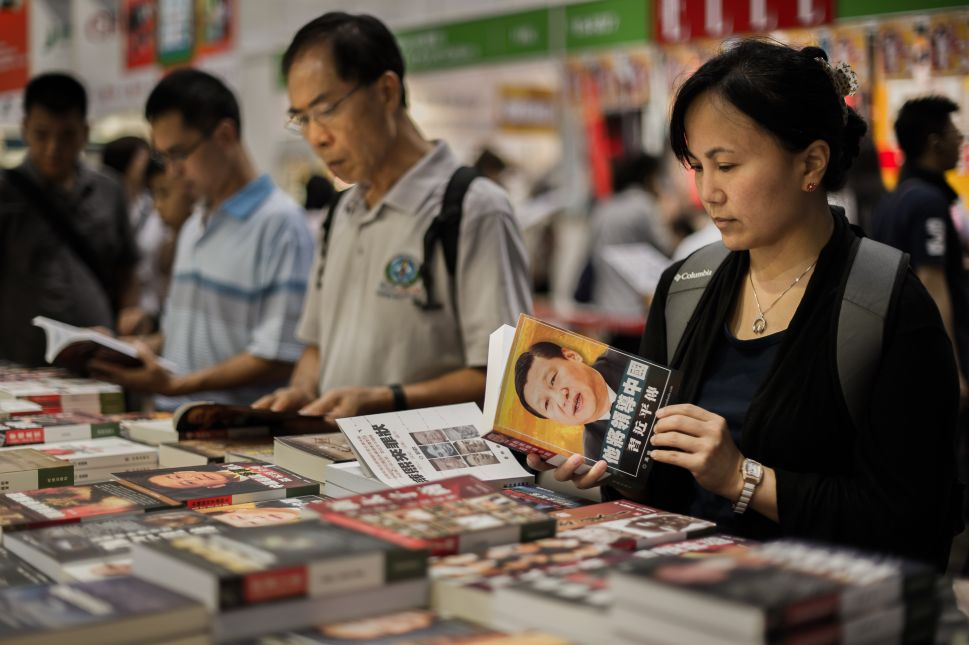 Visitors browse Chinese political books at the Hong Kong Book Fair in Hong Kong on July 18, 2012.