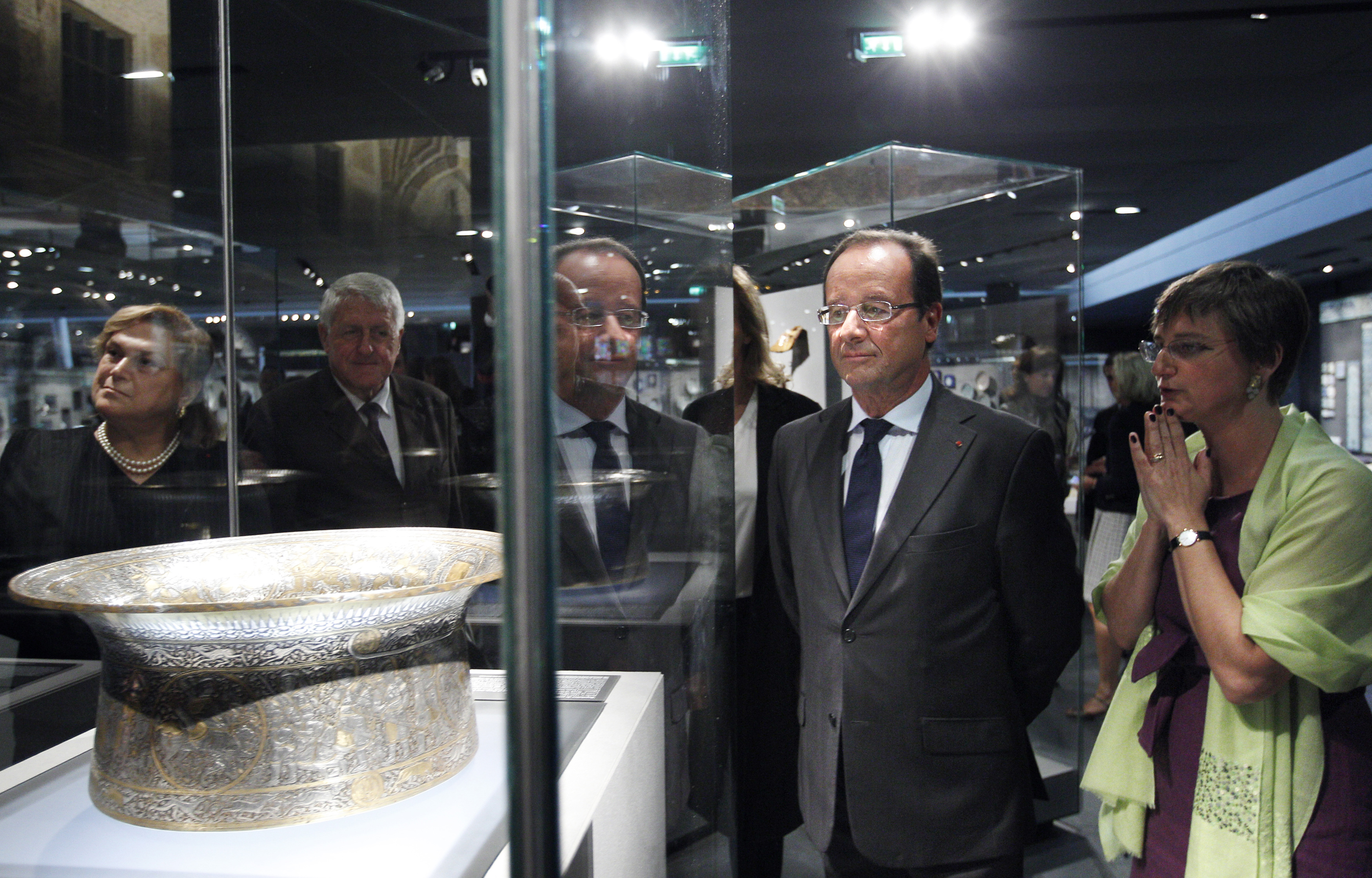 French President Francois Hollande visiting the Department of Islamic Arts galleries at the Louvre in 2012.