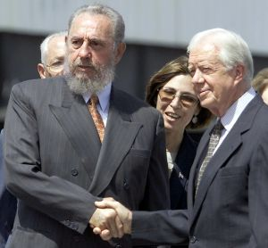 Cuban President Fidel Castro (L) greets former US president Jimmy Carter (R) after Carter's speech in Havana 12 May 2002.