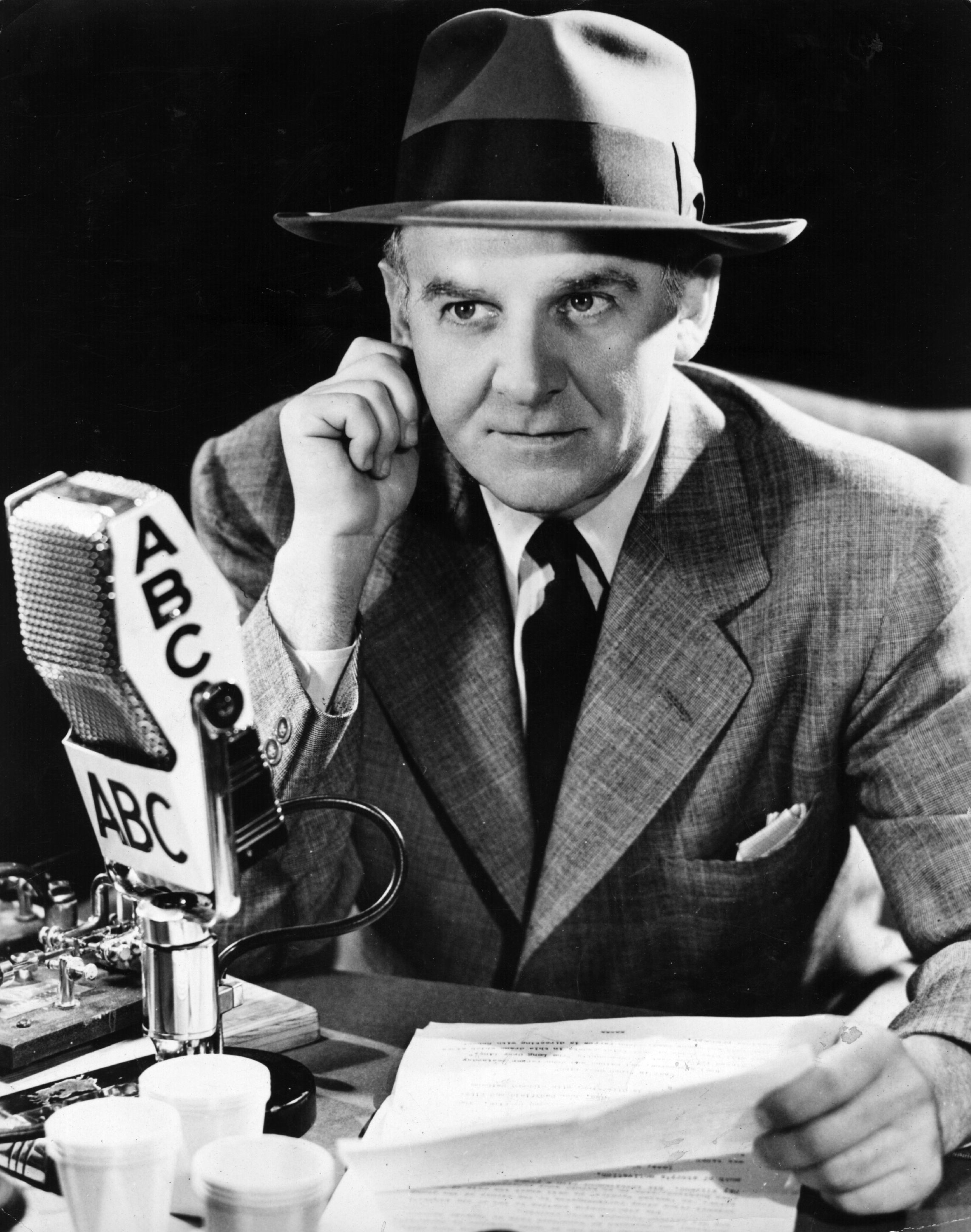 US news commentator, drama critic and gossip columnist Walter Winchell, during a radio broadcast.