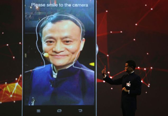 Alibaba's Jack Ma presents on his company's use of facial recognition for payments in Hanover, Germany.