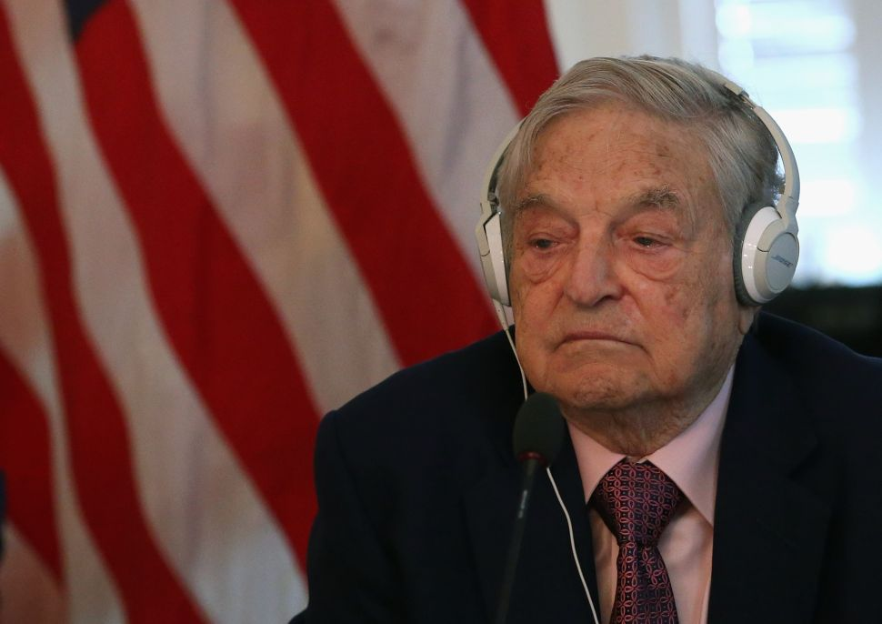 Billionaire George Soros listens to remarks by Commerce Secretary Penny Pritzker and Tunisian President Beji Caid Essebsi during a roundtable discussion with a group of American business leaders, at the Blair House May 20, 2015 in Washington, DC.
