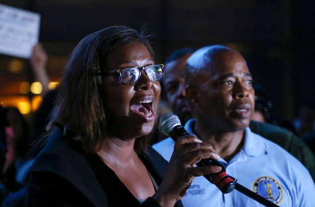 Public Advocate Letitia James speaks during an interfaith candlelight vigil in solidarity with Emanuel AME Church in Charleston, South Carolina outside Barclays Center on June 21, 2015 in the Brooklyn borough of New York City.