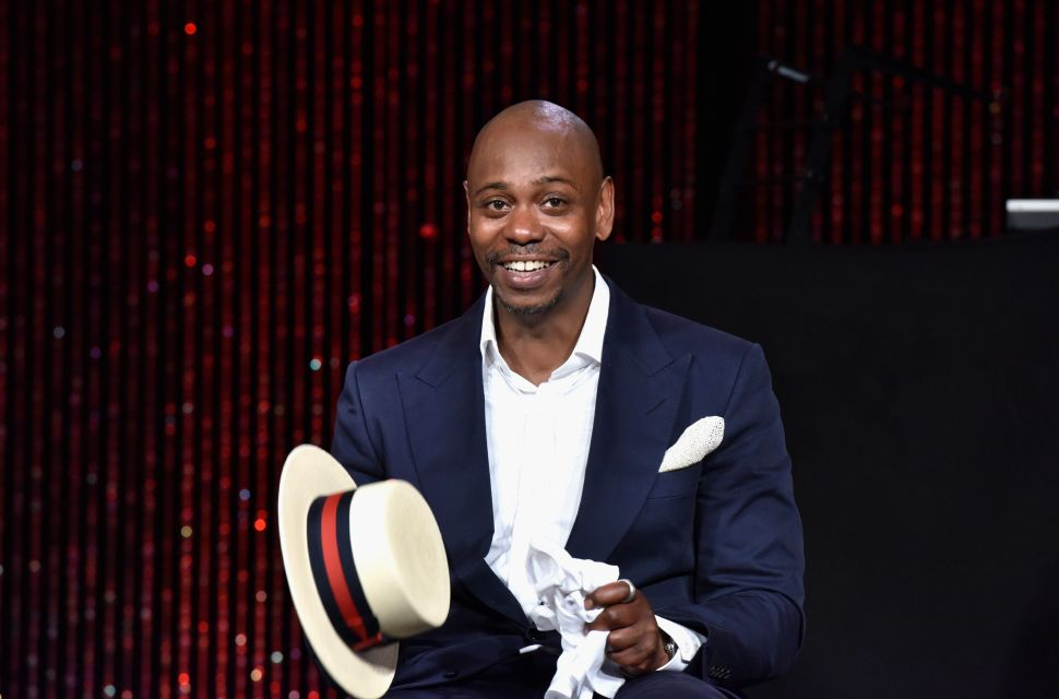 Dave Chappelle speaks on stage as RUSH Philanthropic Arts Foundation Celebrates 20th Anniversary at Art For Life sponsored by Bombay Sapphire Gin at Fairview Farms on July 18, 2015 in Water Mill, New York.