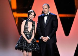 MOUNTAIN VIEW, CA - NOVEMBER 08: Actress Lily Collins (L) and CEO/Co-founder of WhatsApp, Jan Koum speak onstage during the 2016 Breakthrough Prize Ceremony on November 8, 2015 in Mountain View, California. (Photo by Steve Jennings/Getty Images for Breakthrough Prize)