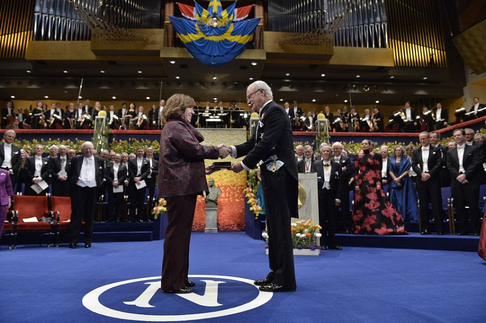 The 2015 Nobel literature laureate Svetlana Alexievich of Belarus receives the award from King Carl Gustaf of Sweden. Now just imagine a robot in her place.