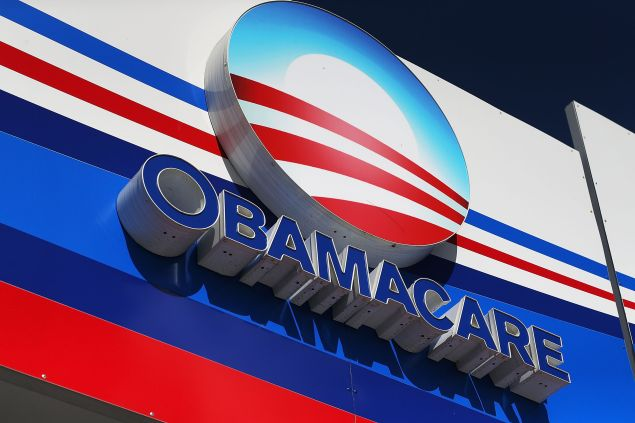 An Obamacare sign is seen on the UniVista Insurance company office on December 15, 2015 in Miami, Florida.