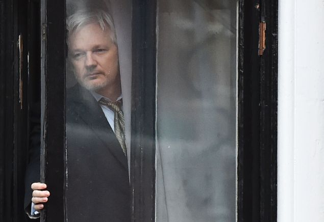 WikiLeaks founder Julian Assange comes out on the balcony of the Ecuadorian embassy to address the media in central London on February 5, 2016.