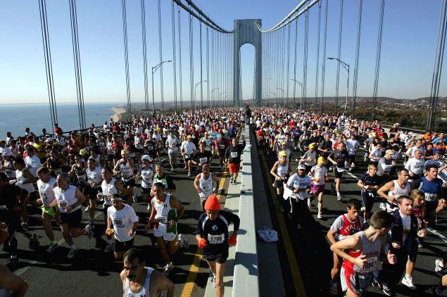 Runners stream over the Verrazano Narrows Bridge at the start of the New York City Marathon.
