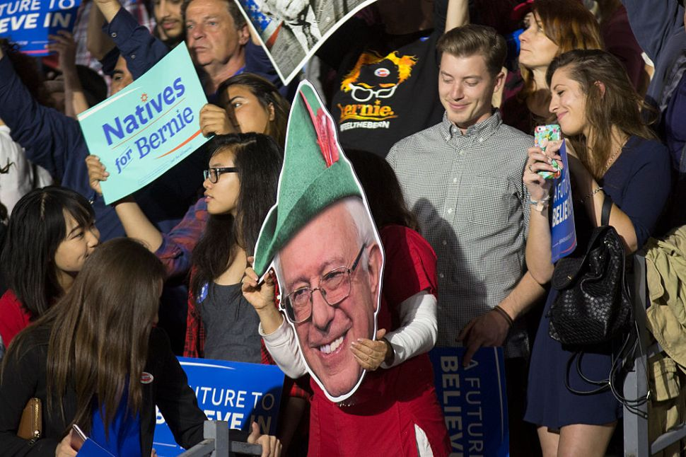 SANTA MONICA, CA - JUNE 07: Supporters carry signs at the California primary election night rally for Democratic presidential candidate Senator Bernie Sanders (D-VT) on June 7, 2016 in Santa Monica, California. Hillary Clinton held an early lead in today's California primary. (Photo by David McNew/Getty Images)