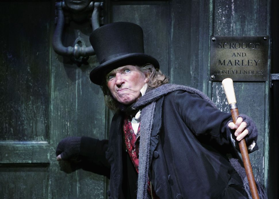 """Actor Tommy Steele poses at a photocall to promote his role as Ebenezer Scrooge in the new stage version of """"Scrooge"""" at the London Palladium on October 27, 2005 in London, England."""