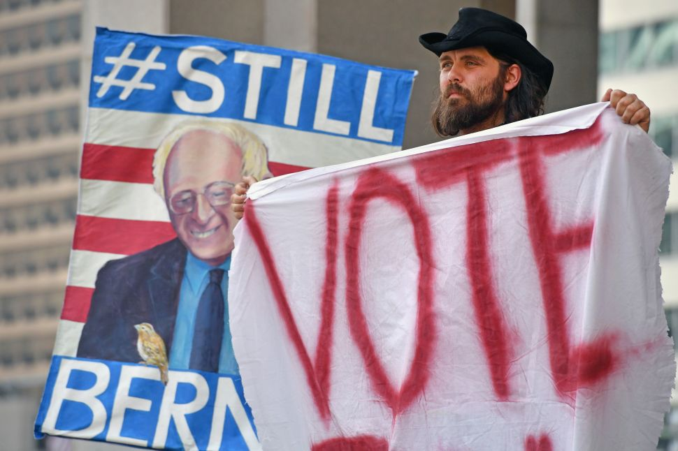 Bernie Sanders supporters gather near City Hall on day three of the Democratic National Convention (DNC) on July 27, 2016 in Philadelphia, Pennsylvania.