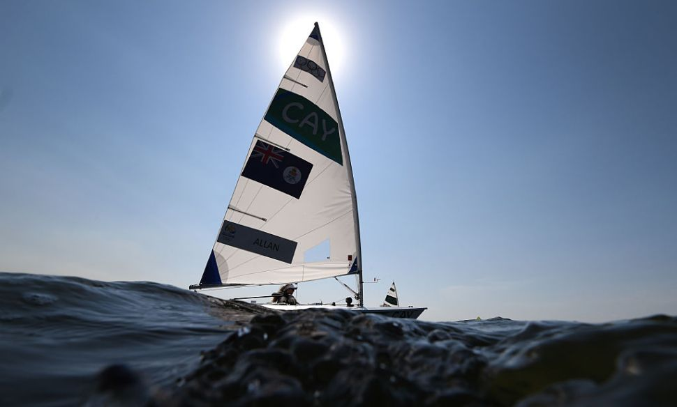 Cayman Islands entry in the Laser Radial sailing class Florence Allan sails during a training session for the 2016 Rio Olympic Games at the Guanabara Bay in Rio de Janeiro, Brazil on August 6, 2016. / AFP / WILLIAM WEST (Photo credit should read WILLIAM WEST/AFP/Getty Images)