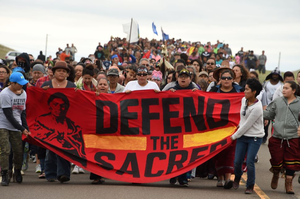 Native Americans march to the site of a sacred burial ground that was disturbed by bulldozers building the Dakota Access Pipeline (DAPL), near the encampment where hundreds of people have gathered to join the Standing Rock Sioux Tribe's protest of the oil pipeline slated to cross the nearby Missouri River, September 4, 2016 near Cannon Ball, North Dakota.