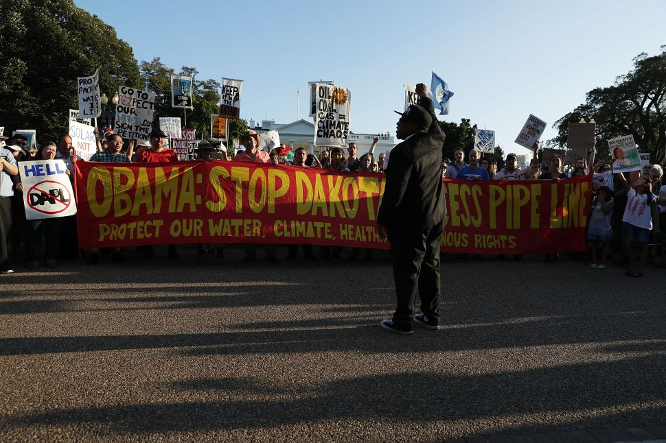 Activists gather in front of the White House during a rally against the Dakota Access Pipeline September 13, 2016 in Washington, DC.