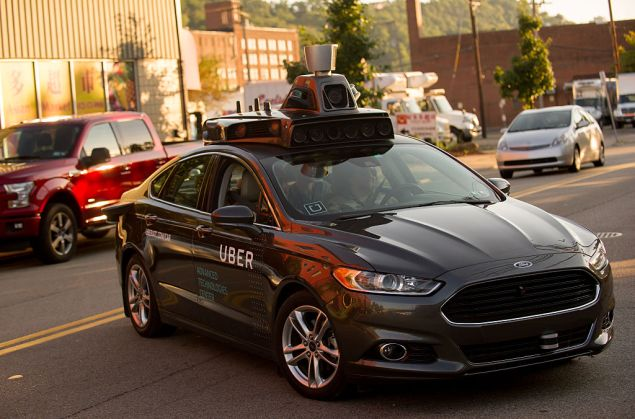 PITTSBURGH, PA - SEPTEMBER 22: An Uber driverless Ford Fusion drives down Smallman Street on September, 22, 2016 in Pittsburgh, Pennsylvania. Uber has built its Uber Technical Center in Pittsburgh and is developing an autonomous vehicle that it hopes will be able to transport its millions of clients without the need for a driver. (Photo by )