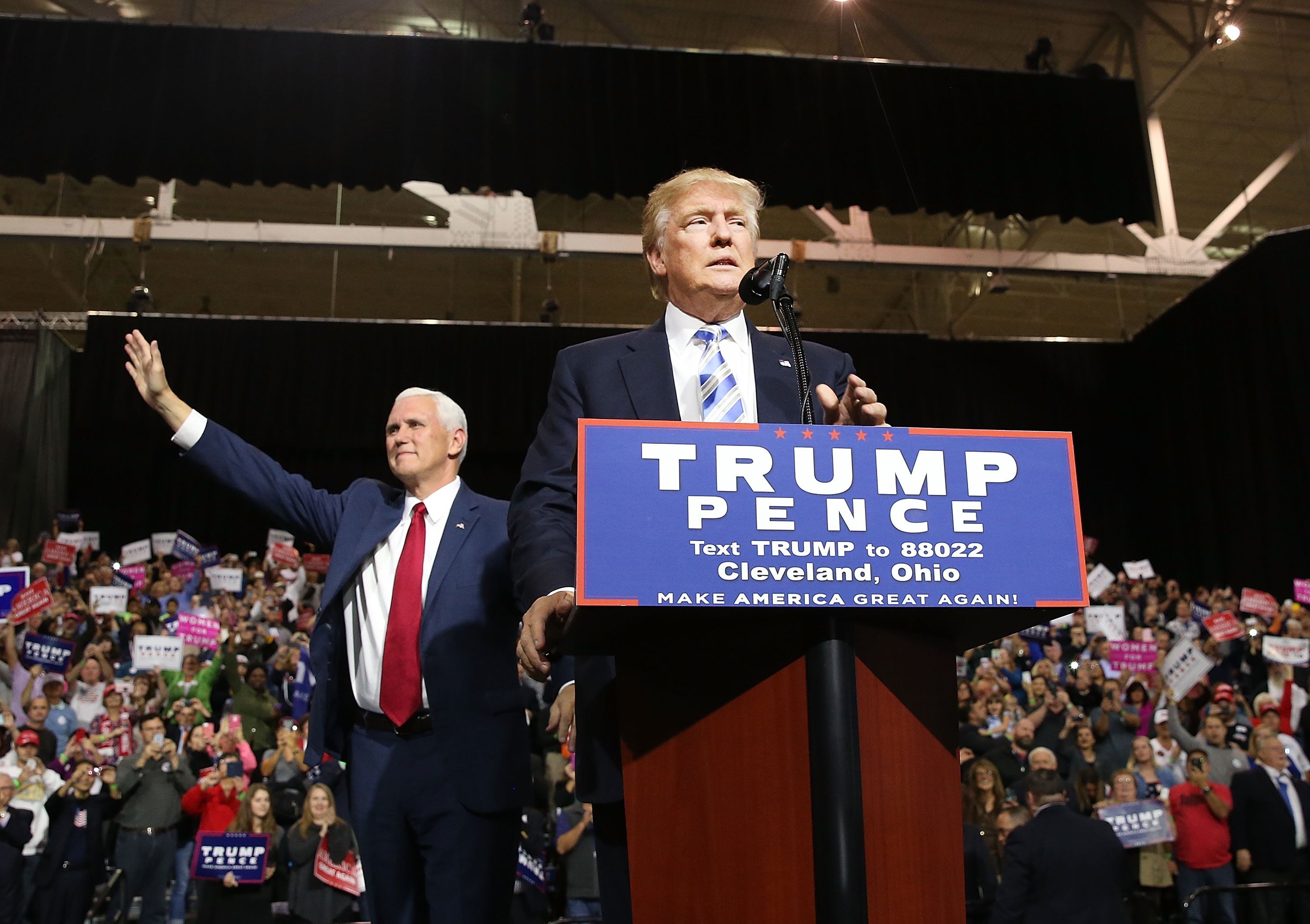 Vice Presidential candidate Mike Pence stands with Donald Trump during a rally on October 22, 2016 in Cleveland, Ohio.