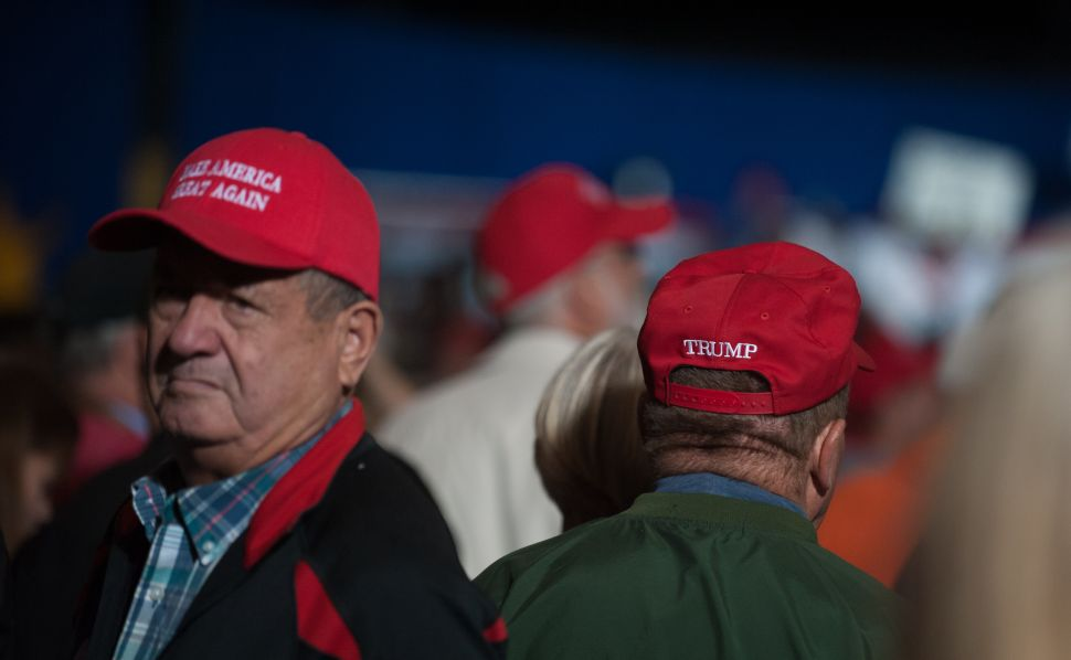 GENEVA, OH - OCTOBER 27: Supporters listen to Republican presidential nominee Donald Trump speak at a campaign rally on October 27, 2016 at the Spire Institute in Geneva, Ohio. Trump spent the day campaigning in Ohio. With less than two weeks to go until election day, Donald Trump continues to campaign in tight battleground states.