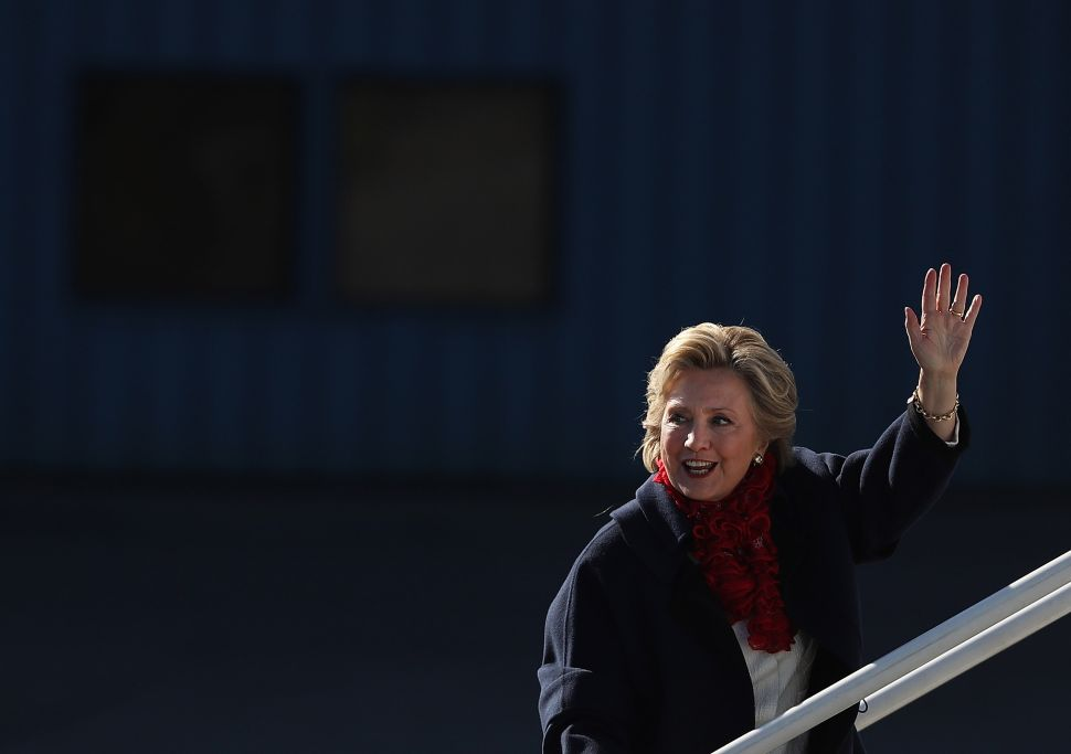 Democratic presidential nominee former Secretary of State Hillary Clinton waves as she boards her campaign plane headed for Florida at Westchester County Airport on November 1, 2016 in White Plains, New York. With one week to go until election day, polls remain tight in many battleground states.