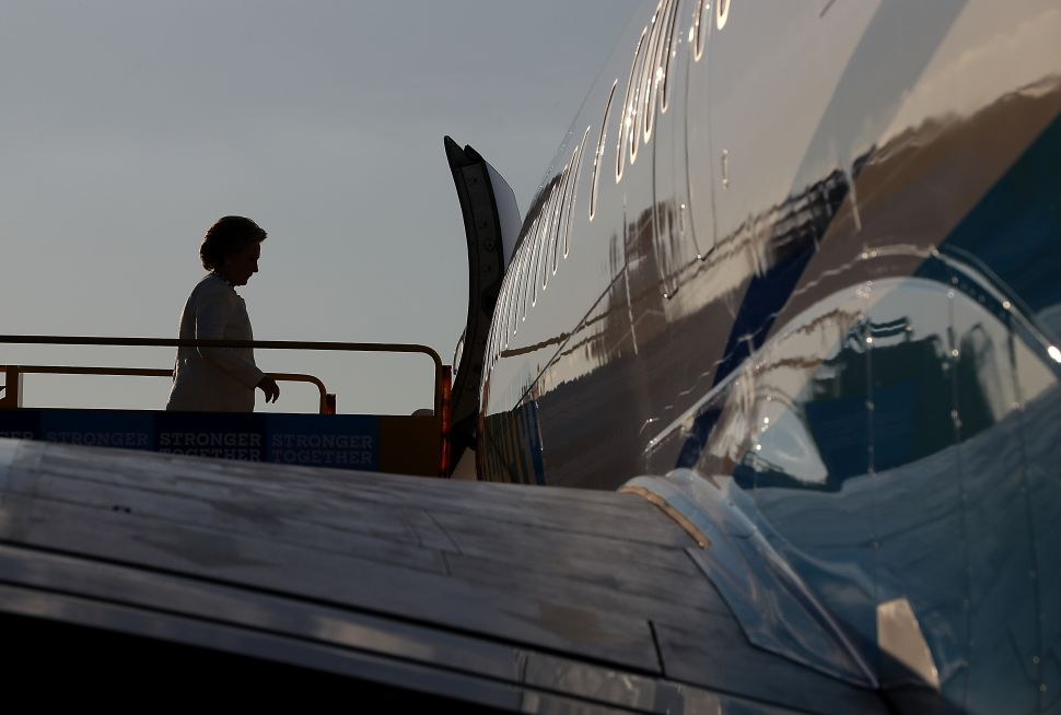 Democratic presidential nominee former Secretary of State Hillary Clinton boards her campaign plane at Lakeland Airport on November 1, 2016 in Lakeland, Florida. With one week to go until election day, Hillary Clinton is campaigning in Florida.