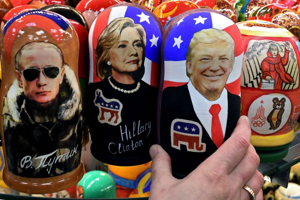 TOPSHOT - Traditional Russian wooden nesting dolls, Matryoshka dolls, depicting Russia's President Vladimir Putin, US Democratic presidential nominee Hillary Clinton and US Republican presidential nominee Donald Trump are seen on sale at a gift shop in central Moscow on November 8, 2016. A nervous world turned its gaze to America's 200 million-strong electorate November 8, 2016 as it chooses whether to send the first female president or a populist property tycoon to the White House. / AFP / Kirill KUDRYAVTSEV