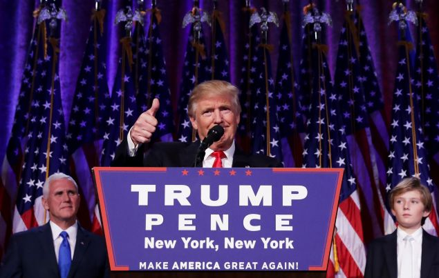Republican president-elect Donald Trump gives a thumbs up to the crowd during his acceptance speech at his election night event in New York.