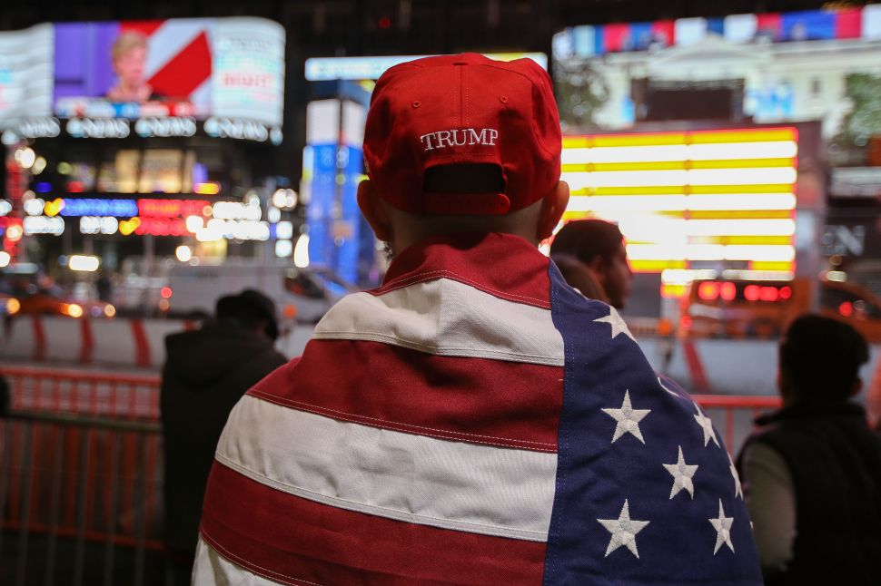NEW YORK, NY - NOVEMBER 09: A Donald Trump supporter watches the screens outside Times Square Studios as he awaits the results of the U.S. presidental election on November 9, 2016 in New York City. Donald Trump defeated Democratic presidential nominee Hillary Clinton to become the 45th president of the United States.