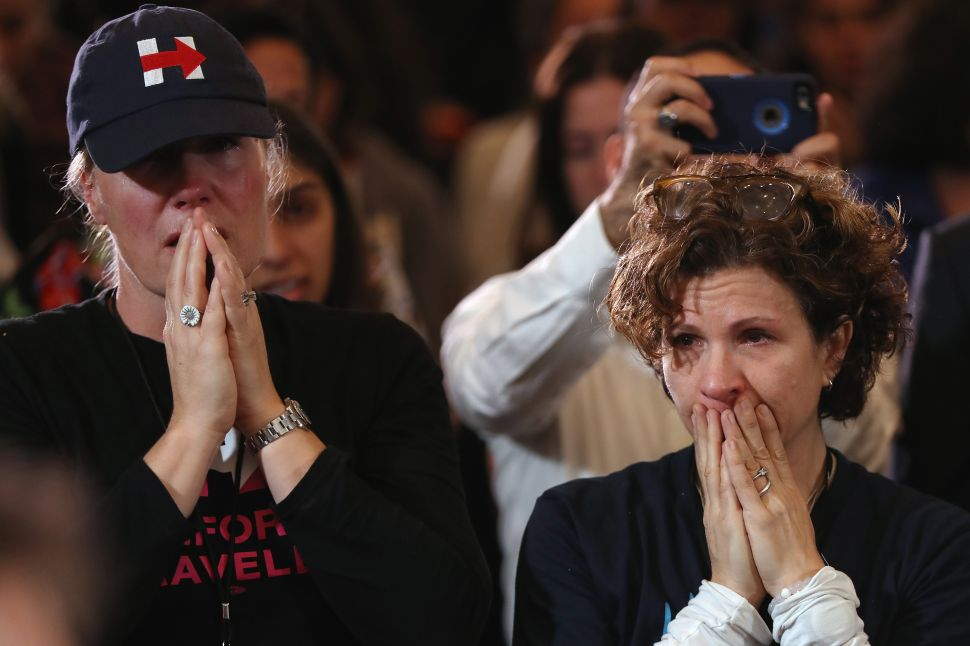 Staffers and supporters react as former Secretary of State Hillary Clinton concedes the presidential election at the New Yorker Hotel on November 9, 2016 in New York City.