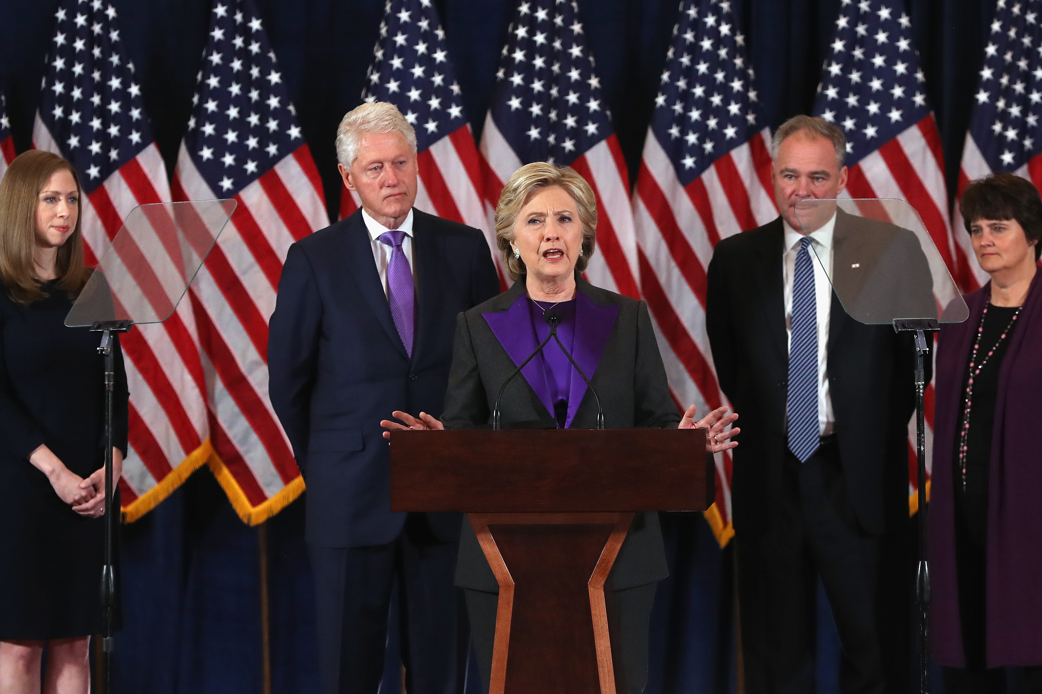 Former Secretary of State Hillary Clinton concedes the presidential election as (L-R) Chelsea Clinton, Bill Clinton, Tim Kaine and Anne Holton listen at the New Yorker Hotel on November 9, 2016 in New York City.