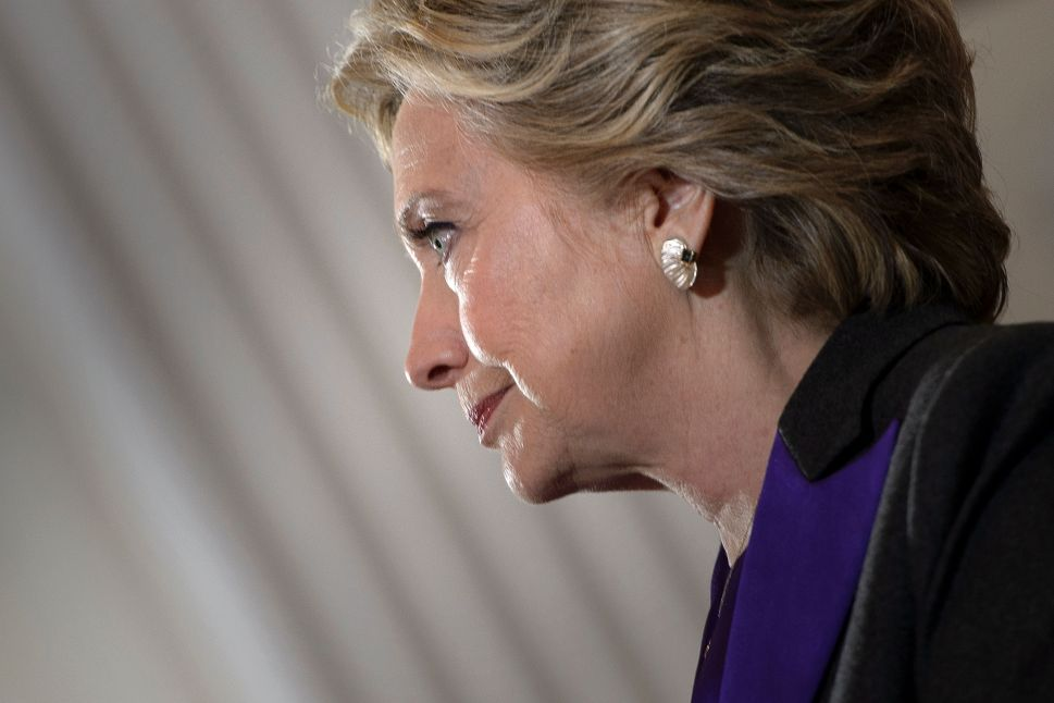 Former Democratic US Presidential candidate Hillary Clinton pauses while speaking to supporters at the New Yorker Hotel after her defeat last night in the presidential election November 9, 2016 in New York.
