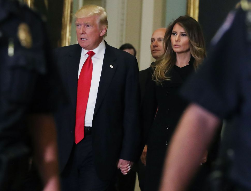 President-elect Donald Trump, his wife Melania Trumpwalk to a meeting with Senate Majority Leader Mitch McConnell at the U.S. Capitol for a meeting November 10, 2016 in Washington, DC. Earlier in the day president-elect Trump met with U.S. President Barack Obama at the White House.