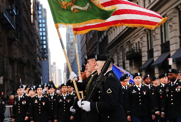 Members of the U.S. military march in the nation's largest Veterans Day Parade in New York City on November 11, 2016 in New York City. Known as 'America's Parade' it features over 20,000 participants, including veterans of numerous eras, military units, businesses and high school bands and civic and youth groups.