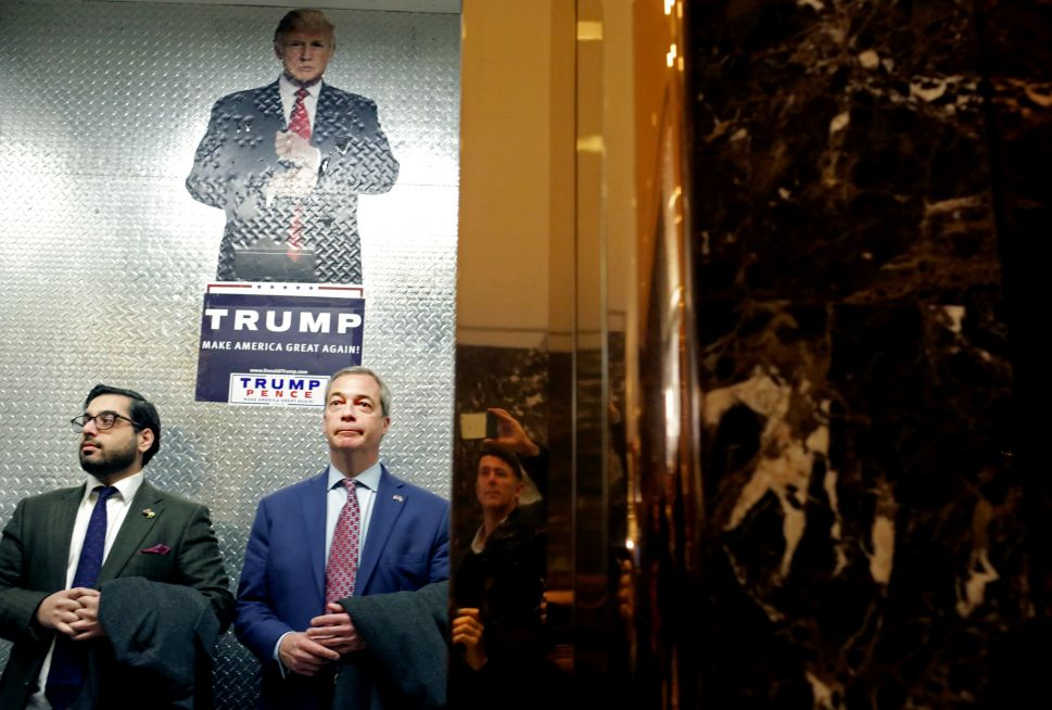 Nigel Farage (C), leader of the UK Independence Party, arrives to Trump Tower on November 12, 2016 in New York City. President-elect Donald Trump is holding meetings at his Trump Tower residence amid increased security in the area.