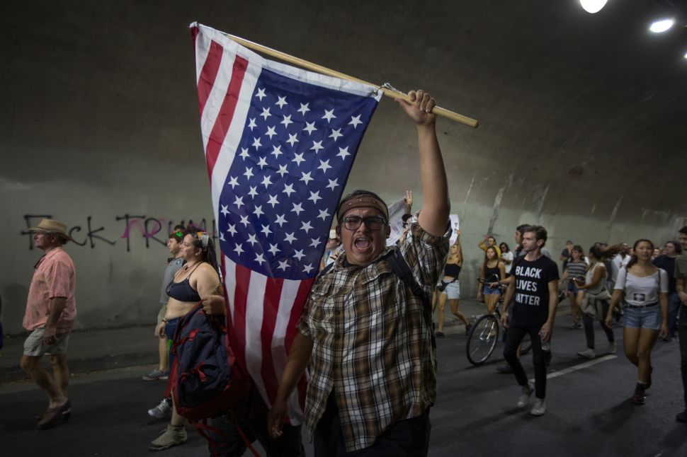 Protesters pass through a tunnel as the march in reaction to the upset election of Republican Donald Trump over Democrat Hillary Clinton in the race for President of the United States on November 12, 2016 in Los Angeles, California, United States. Hundreds of Angelenos have been arrested in recent days and some have vandalized property but the vast majority of the thousands of protesters have remain peaceful.
