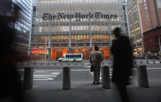 The New York Times' masthead is displayed in front of the midtown headquarters on December 7, 2009 in New York City.
