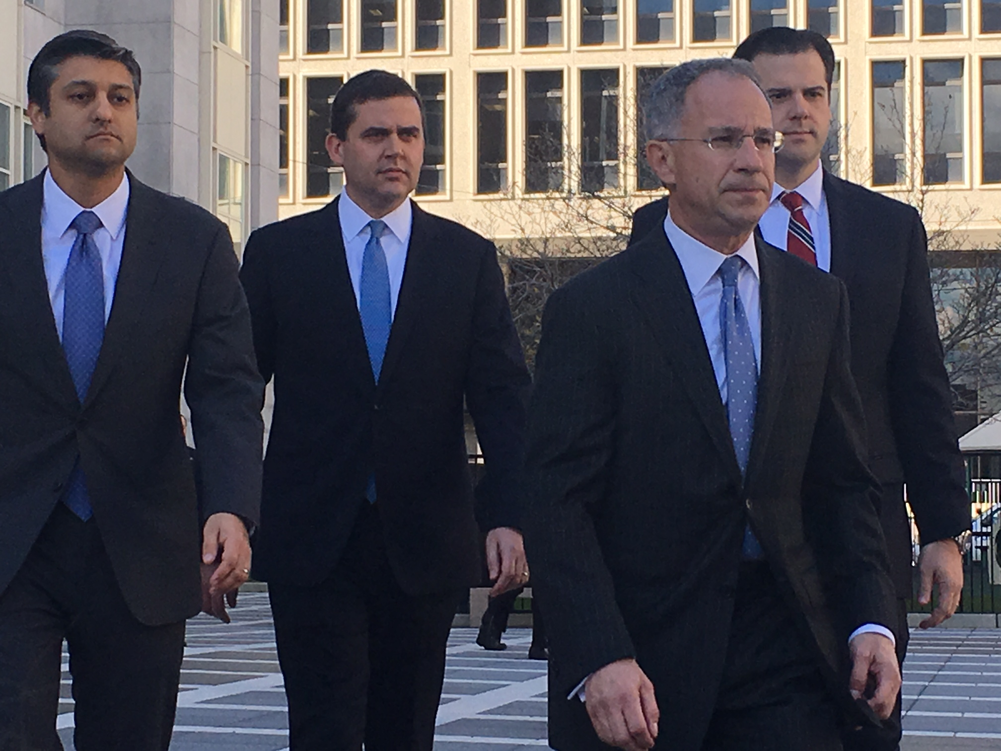 U.S. Attorney Paul Fishman and the three assistant prosecutors who represented the government during the trial approach reporters following the Bridgegate verdict.