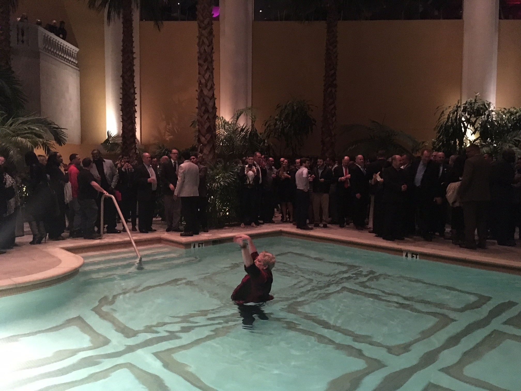 A guest takes a dip in the pool during Murphy's Borgata event.