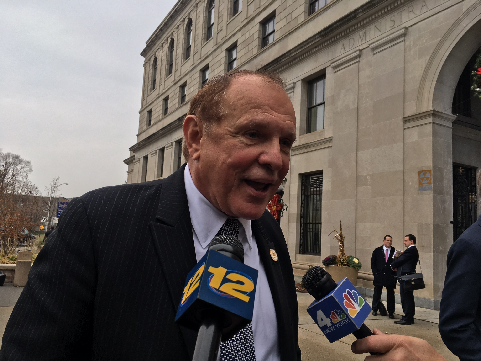 Lesniak speaks to reporters outside of the courthouse in Hackensack.