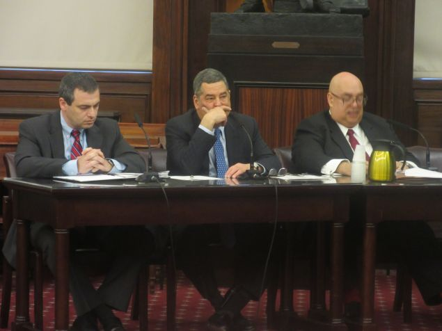 NYPD's Larry Byrnes, center, during a City Council hearing on the nuisance abatement law.