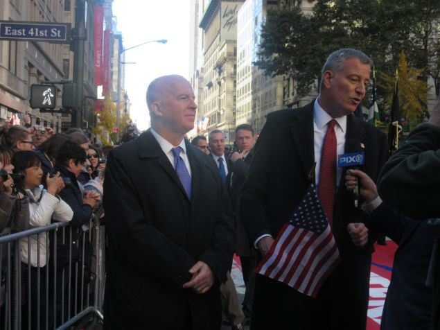 Police Commissioner James O'Neill and Mayor Bill de Blasio address Pix 11 journalist during Veterans' Day Parade.