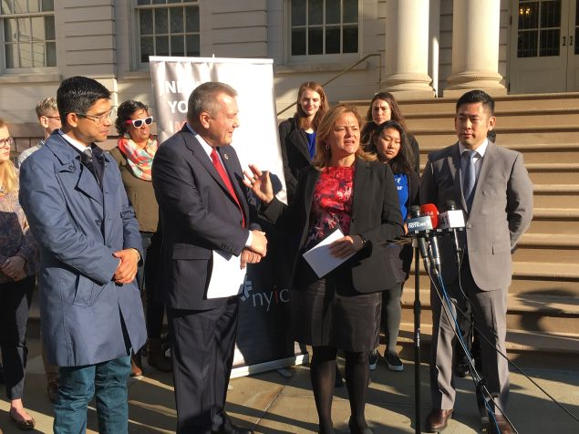Council Speaker Melissa Mark-Viverito, center, joins lawmakers in blasting fraudulent immigration services in front of the City Hall steps.
