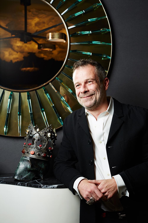 Benoist Drut, interior designer and partner with Mason Gerard gallery inside of his booth, Salon Art + Design Fair at the Park Avenue Armory, New York, New York, November 11th, 2016. Yvonne Albinowski/For New York Observer