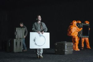 Amy Adams with a sample of the alien writing in Arrival.