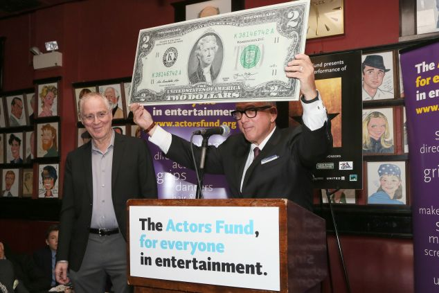 Author Ron Chernow and Actor's Fund treasurer Steve Kalafer joke around with a 2-dollar bill that depicts Hamilton's rival, Thomas Jefferson Jay Brady Photography