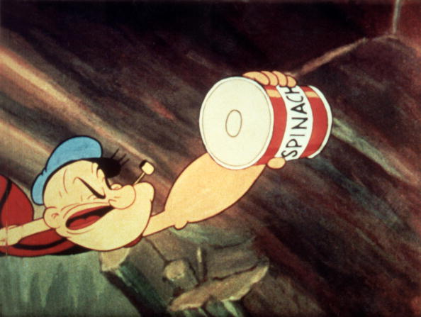 Popeye reaches for a can of spinach in a still from an unidenitified Popeye film, c. 1945.