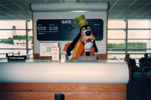 The AMA host dressed as Goofy in the airport.