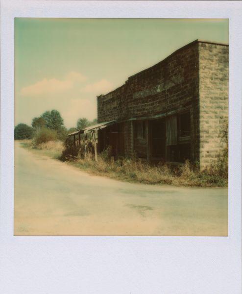 Walker Evans' [Abandoned Storefronts, Hale County, Alabama].