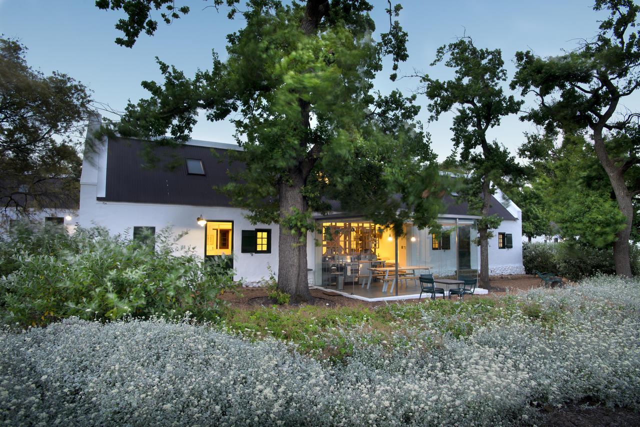 Glass box kitchens overlook the working farm at Babylonstoren